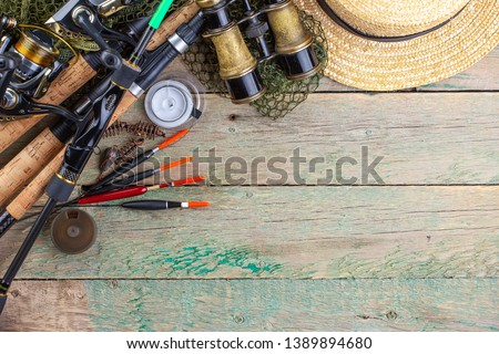 fishing tackle on a wooden table.  #1389894680