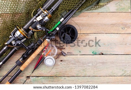 fishing tackle on a wooden table.  #1397082284
