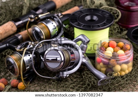 fishing tackle on a wooden table.  #1397082347
