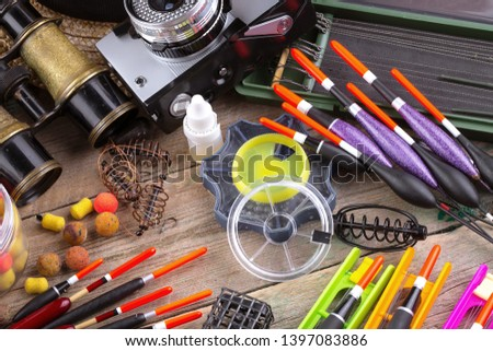 fishing tackle on a wooden table.  #1397083886