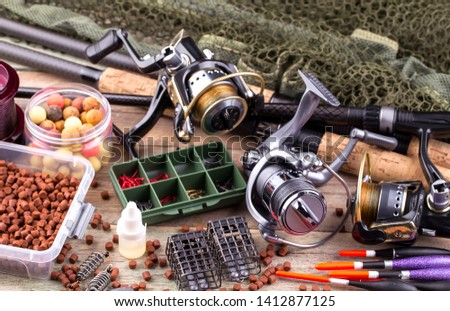 fishing tackle on a wooden table.  #1412877125