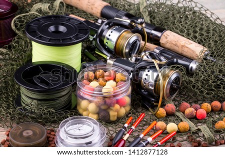 fishing tackle on a wooden table.  #1412877128