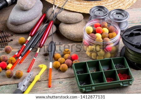 fishing tackle on a wooden table.  #1412877131