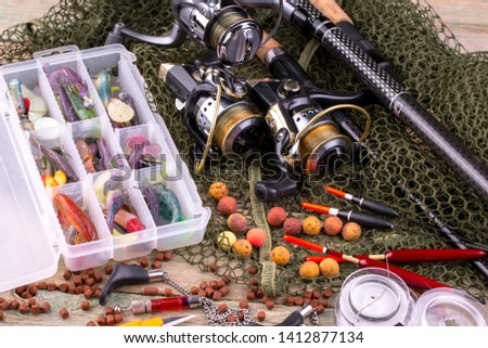 fishing tackle on a wooden table.  #1412877134
