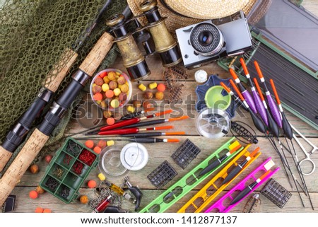 fishing tackle on a wooden table.  #1412877137