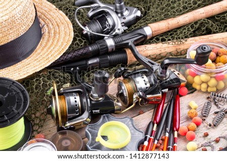 fishing tackle on a wooden table.  #1412877143