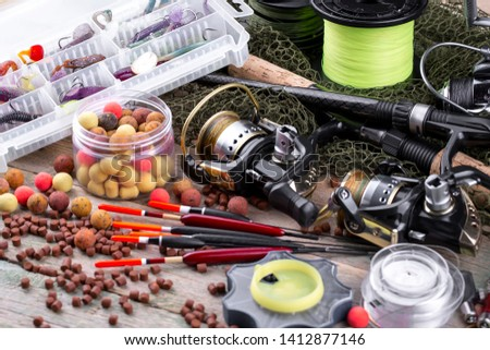 fishing tackle on a wooden table.  #1412877146