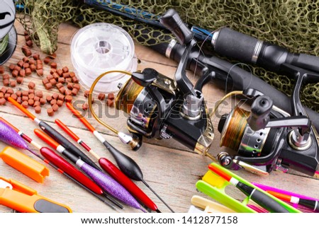 fishing tackle on a wooden table.  #1412877158