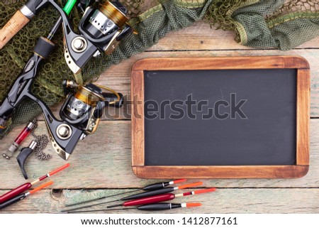 fishing tackle on a wooden table.  #1412877161