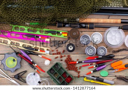 fishing tackle on a wooden table.  #1412877164