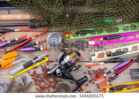 fishing tackle on a wooden table.  #1446005675