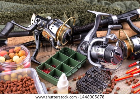 fishing tackle on a wooden table.  #1446005678