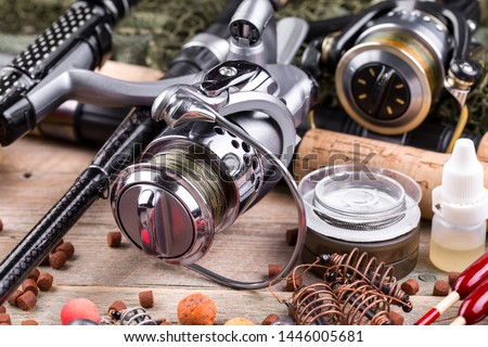 fishing tackle on a wooden table.  #1446005681