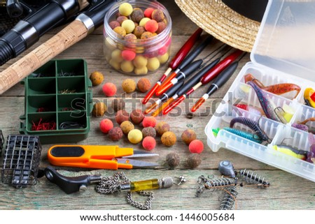 fishing tackle on a wooden table.  #1446005684