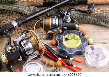 fishing tackle on a wooden table.  #1446005690