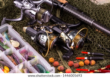 fishing tackle on a wooden table.  #1446005693