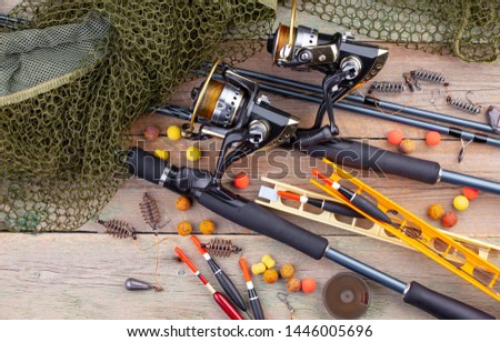 fishing tackle on a wooden table.  #1446005696