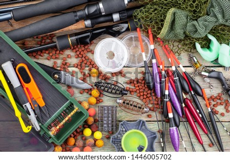 fishing tackle on a wooden table.  #1446005702
