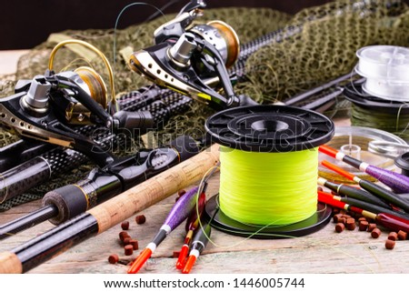 fishing tackle on a wooden table.  #1446005744