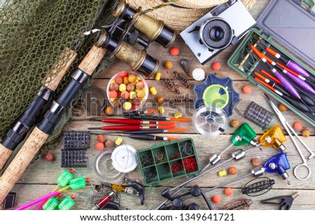 fishing tackle on a wooden table. toned image  #1349641721