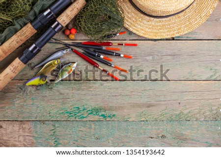 fishing tackle on a wooden table. toned image  #1354193642