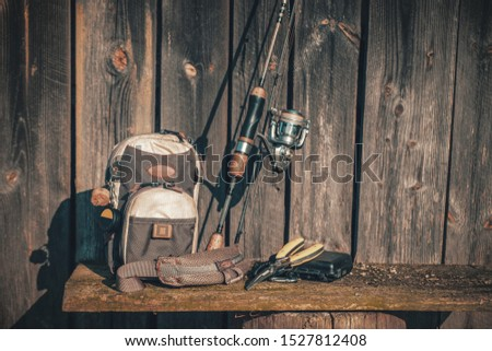 Fishing tackle on a wooden wall background. #1527812408