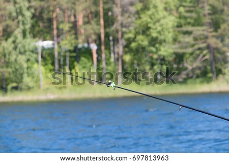 Fishing tackle on the background of water #697813963