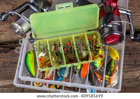 Fishing Tackles And Baits In Box On Vertical Wooden Board Background Design For Outdoor