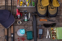 fishing tackles and fishing gear on tinber boards look on top