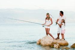 Fishing team - family fishing at the beach