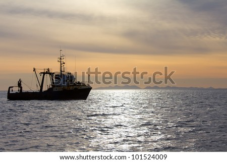 Fishing trawler during a storm in Pacific ocean near Commander Islands. Kamchatka