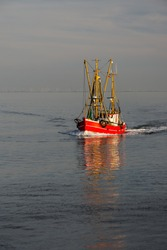 Fishing trawler on the North Sea at the coast of Buesum, Schleswig-Holstein, Germany