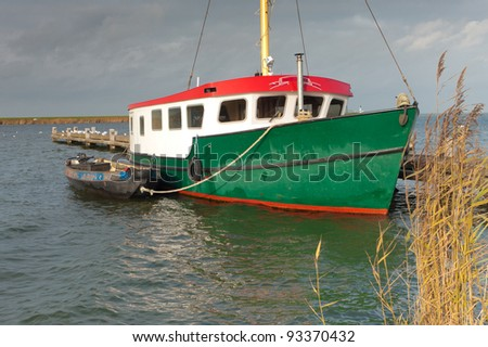 fishing trawler with small boat