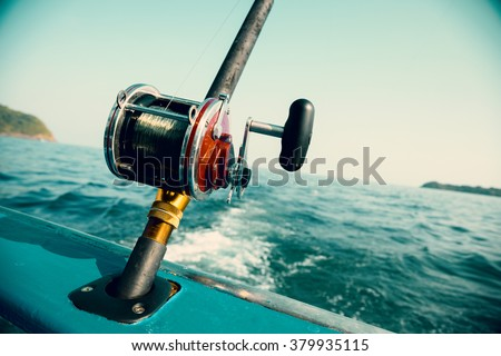 Fishing trolling tuna with a motor boat in the Andaman Sea coast of Thailand. Image retro vintage filter effect.
