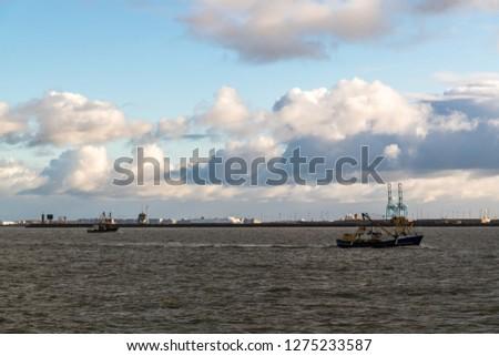 Fishing vessels in front of the port of Zeebrugge, Belgium. #1275233587