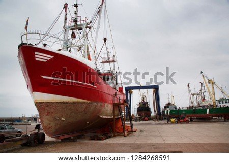 fishing vessels on the quay and in the dry dock for maintenance and repair #1284268591