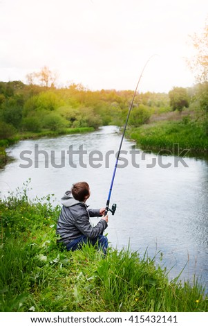 Fishing with a fishing rod on the river #415432141