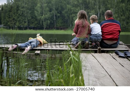 stock photo : fishing with dad. Three kids are fishing with dad