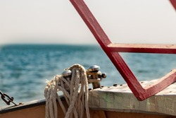 Fishingboat winch and rope yacht detail.