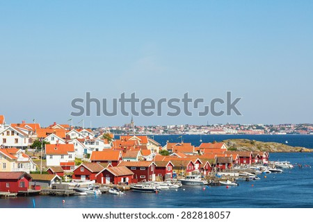 Fiskebackskil an old fishing village on the Swedish west coast, with Lysekil city in the background