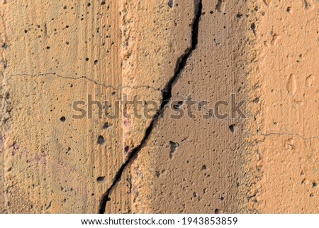 Fissure and crack on a concrete wall. Paint color - Mongoose, Tumbleweed, Hue Brown. Photo stock ©