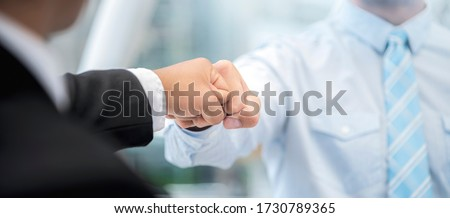 Fist bump collide agreement of two businessman, show strength teamwork, handshake negotiations finish together after good deal,panoramic banner. Foto stock ©