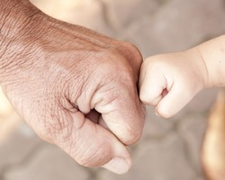 Fist bump with hard and soft hands