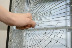 Fist demolishing windowpane