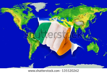 Fist in color national flag of ireland punching world map as symbol of export, economic growth, power and success