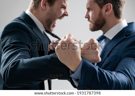 fist of punching disagreed men business partners or colleague disputing and fighting aggressive and angry while conflict, selective focus, corporate battle. Сток-фото ©