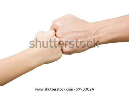 Fist of the child rests on the fist man on an isolated white background