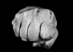 Fist on black background