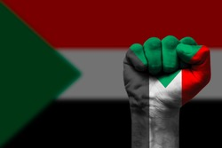 Fist painted in colors of Sudan flag, fist flag, country of Sudan