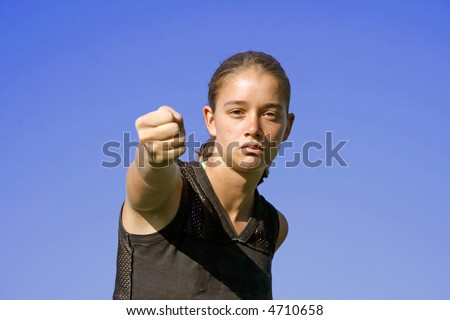 fist punch - attractive young woman practicing self defense